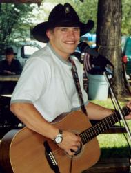 Musician strums a guitar at the Camas Festival